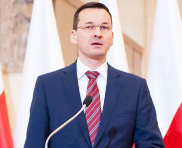 articleImage: Premier popiera ustawę o IPN, ale termin uchwalenia krytykuje