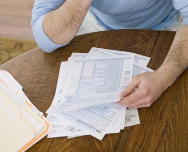 articleImage: W jaki sposób należy zgłosić do Urzędu Skarbowego zmianę dowodu osobistego oraz miejsca zamieszkania i zameldowania?